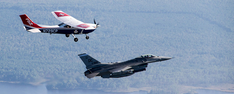 A Civil Air Patrol Cessna is intercepted by an F-16 from tje D.C. Air National Guard.