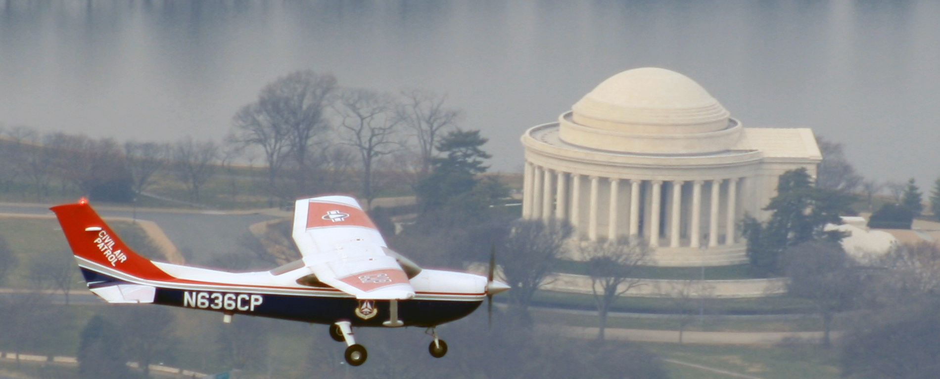 A Cessna from Civil Air Patrol's National Capital Wing flies over the Jefferson Memorial.