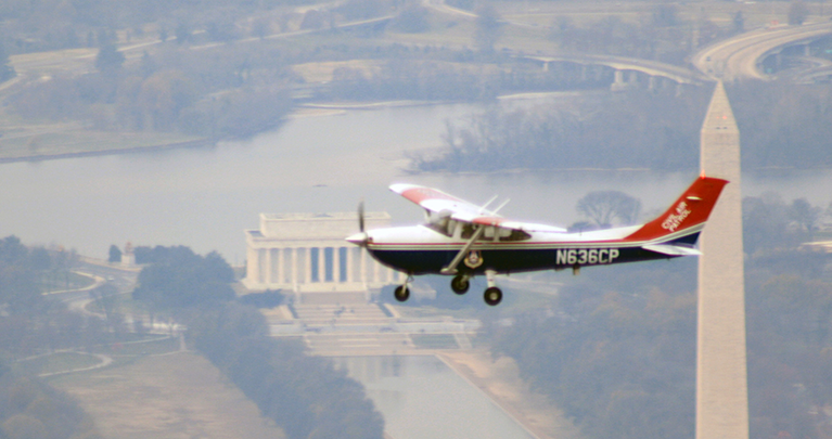 A Civil Air Patrol Cessna flying over the National Mall.