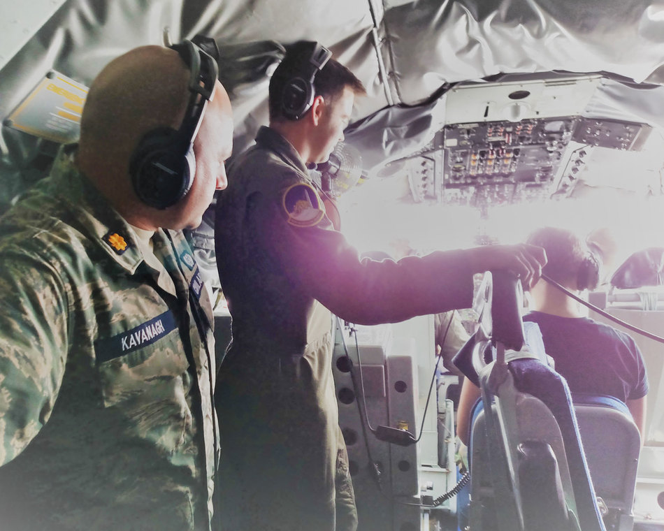 Observing a military aircrew at work during a cadet orientation flight.
