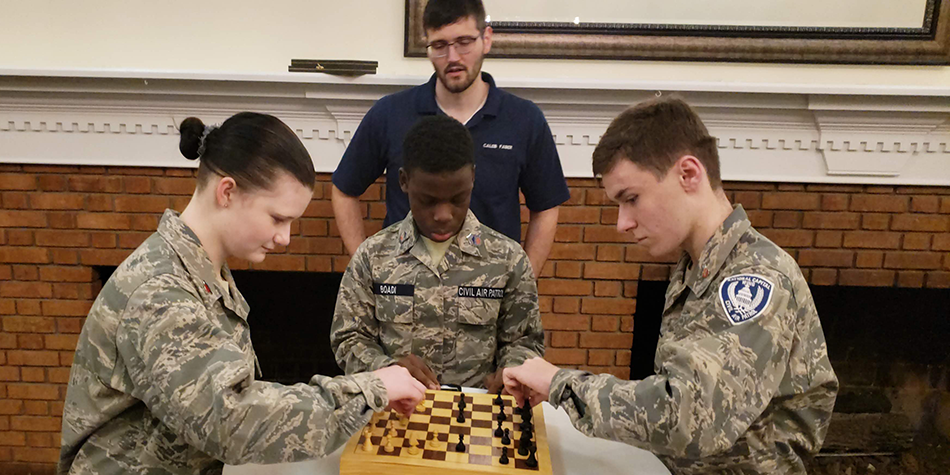 Cadets learn to play chess.