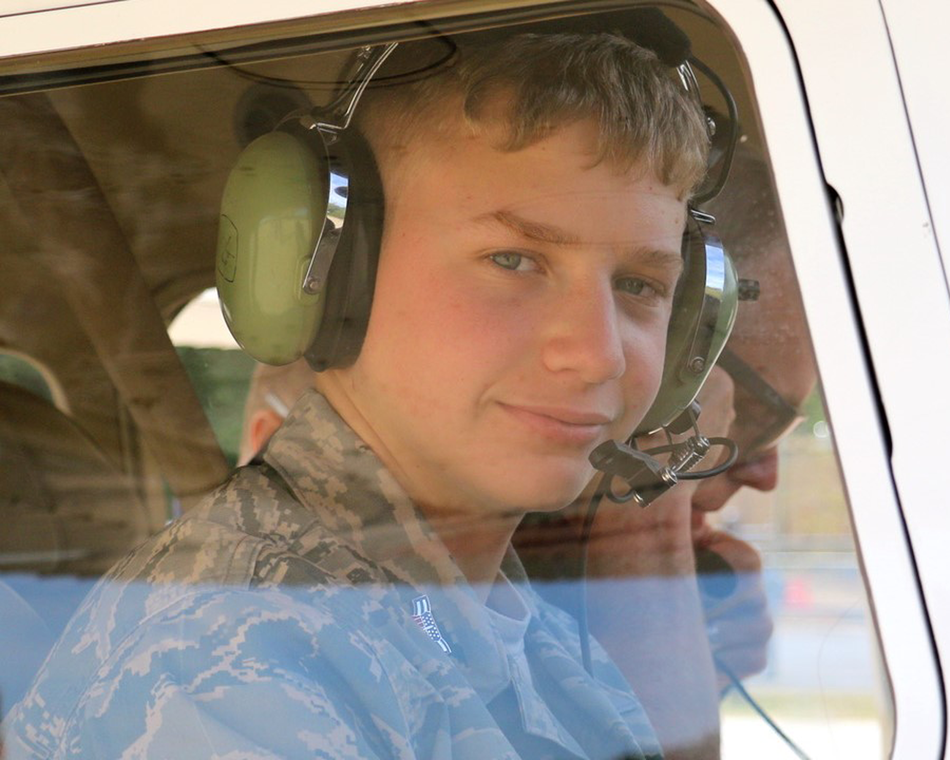 A cadet takes his first orientation ride in a CAP airplane.