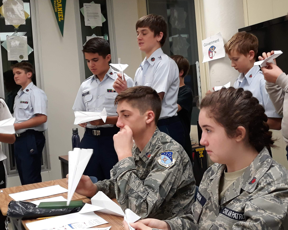 Cadets learn about aerodynamics though paper airplanes.