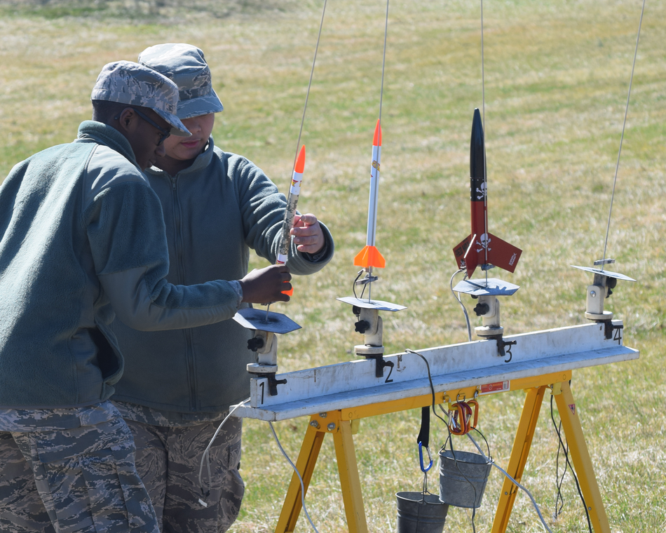 Cadets prepare to launch model rockets.