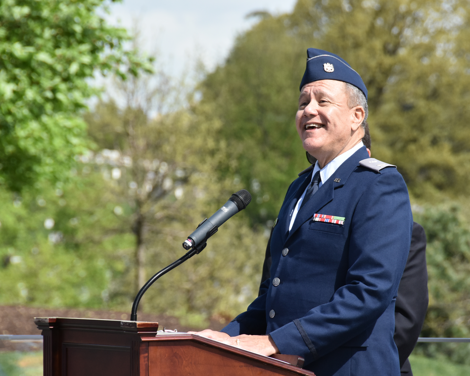 A member sings the national anthem during a ceremony at the Air Force Memorial.