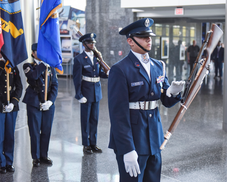 A cadet participates in a joint honor guard at the DIA.