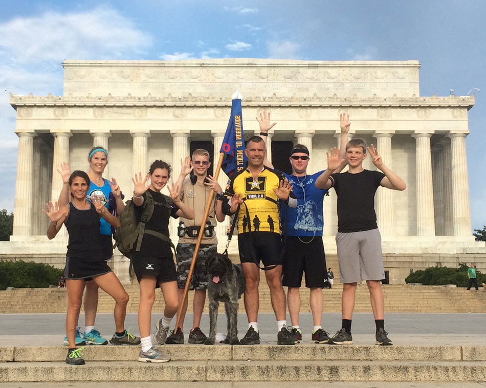 Cadets and active members run in front of the Lincoln Memorial to prepare for the Army 10-miler.
