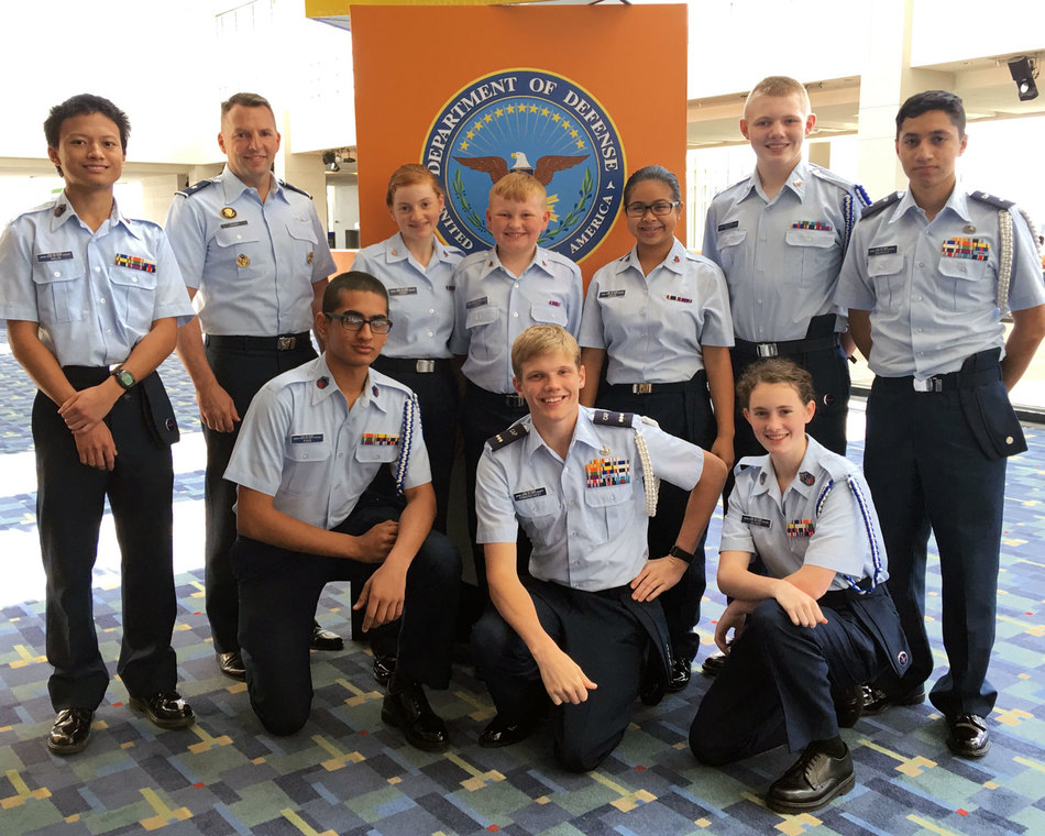 Cadets pose with an Air Force general at the Pentagon.